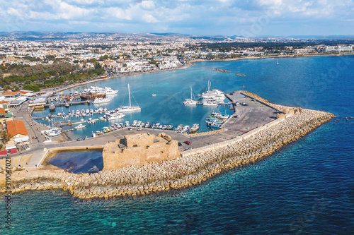 Tablou Canvas Famous Paphos Castle in harbour on embankment or promenade of city Paphos in Cyprus, aerial drone view