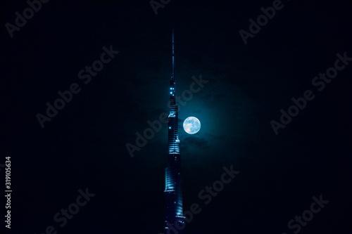 Obraz na plátne Illuminated Burj Khalifa Against Sky At Night