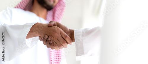 Slika na platnu Successful of arab business partner handshake together in modern office