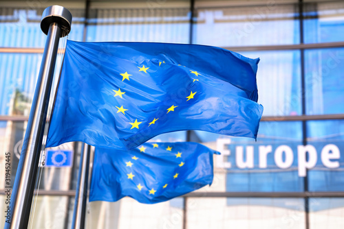 European Union flags waving in front of European Commission. Fototapeta