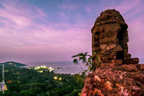Slika na platnu Old Ruin On Mountain Against Sea At Sunset