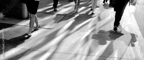 Fotografia Low Section Of People Walking On Sidewalk In City
