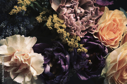 Beautiful bouquet of different flowers, closeup. Floral card design with dark vintage effect