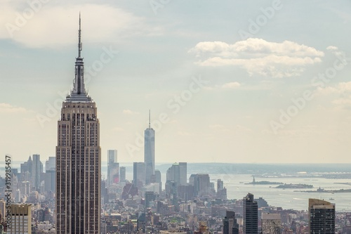Photo Empire State Building Against Towers At Manhattan