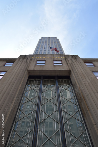 фотография Low Angle View Of Empire State Building Against Sky