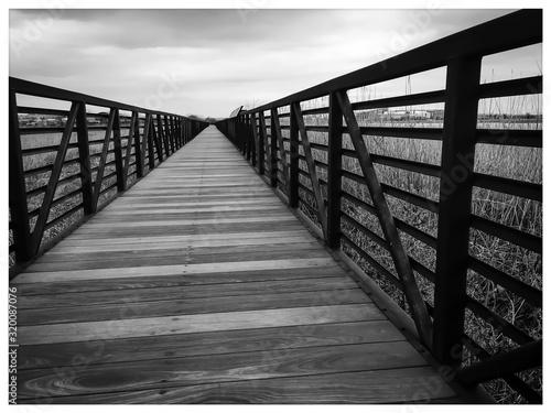 Fotografiet Surface Level Of Footbridge Against The Sky