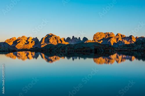 Canvas Print Lake Nero with Brenta mountain chain reflection, Dolomites (IT)