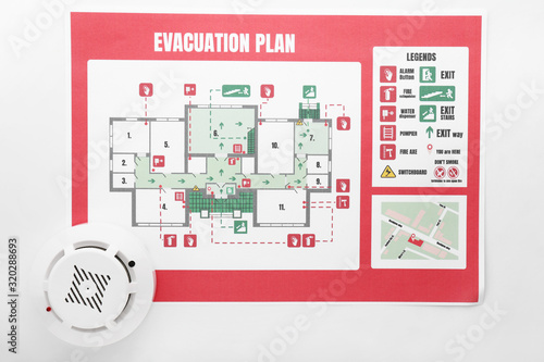 Wallpaper Mural Evacuation plan and smoke detector on white background