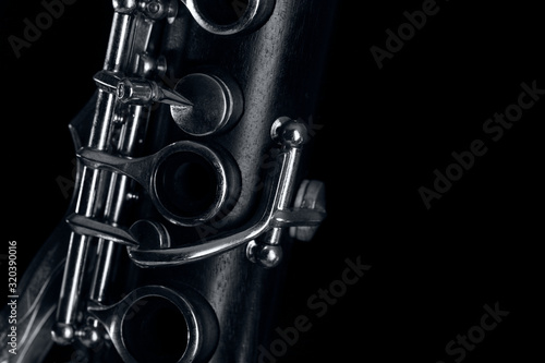 Canvas-taulu wooden clarinet on black