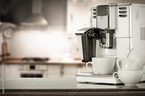 Coffee machine and blurred kitchen interior. Fototapet