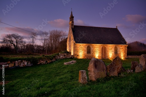 Leinwand Poster Beautiful chapel during the night in brittany. France