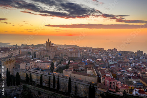 Aerial sunrise view of the medieval walled center of Tarragona in Catalunya Spain with the cathedral, city walls, bastions and towers