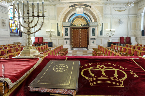 Fotografie, Obraz Holy book and menorah on altar in Moroccan synagogue.