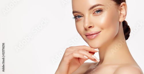 Beautiful young woman with clean fresh skin touching her face Fototapet