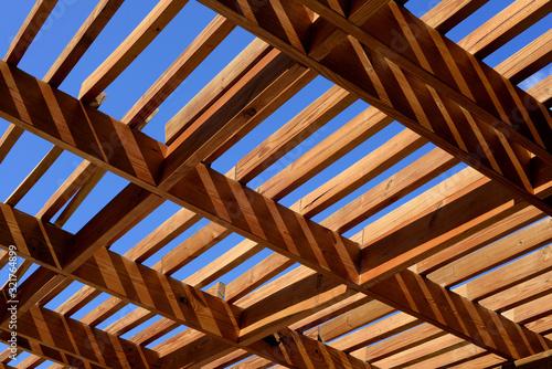 Fotografia, Obraz wooden pergola in the sun with blue sky