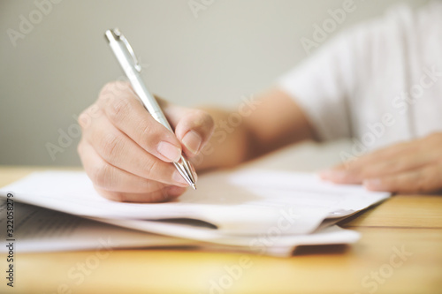 Fotomural Hand of man signing signature filling in application form document