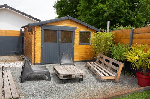 Small wooden cabin house exterior design Fototapeta