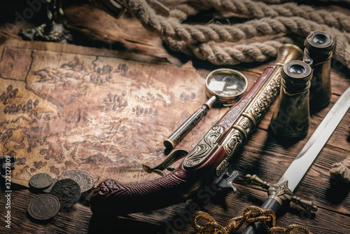 Pirate treasure map on brown wooden table background. Fototapeta