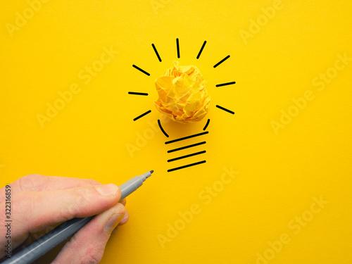Yellow crumpled paperball as lightbulb