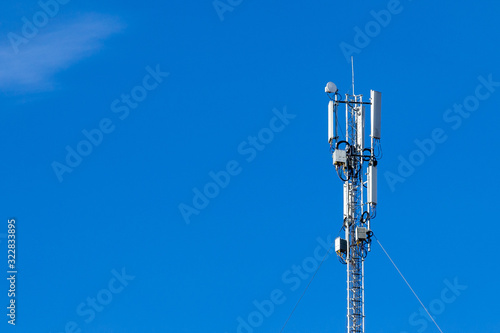 Fotografía Telecommunications equipment - directional mobile phone antenna dishes on an extension tower