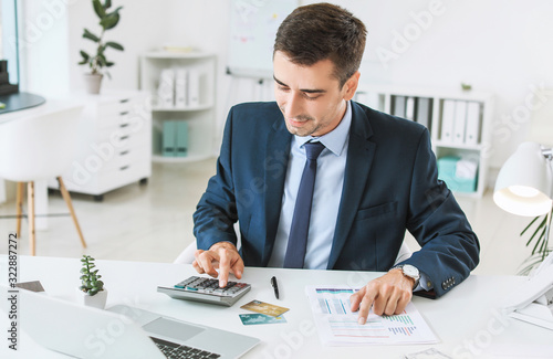 Male bank manager working in office Fototapeta