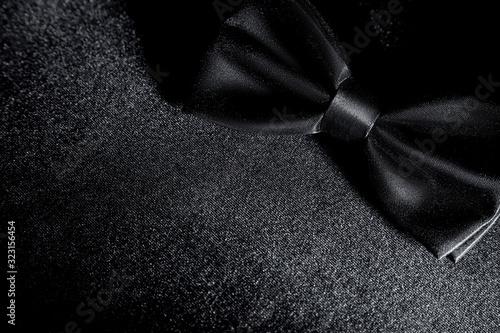 Black bow butterfly on a black background Fototapet