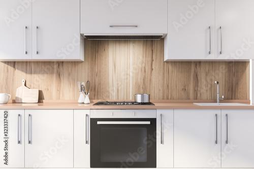 Wooden kitchen with white countertops Fototapeta