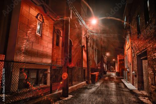 Fényképezés Dark and eerie urban city alley at nightin the winter