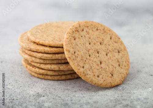 Stack of various organic crispy wheat crackers with sesame and salt on light kitchen table background Tapéta, Fotótapéta