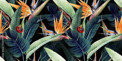 Seamless floral pattern with tropical leaves and strelitzia on red background. Template design for textiles, interior, clothes, wallpaper. Watercolor illustration