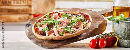 Obraz na plátně Crusty oven-fired Italian prosciutto pizza
