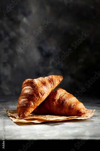 Cuadros en Lienzo Fresh croissant on dark mood background and copy space for your product
