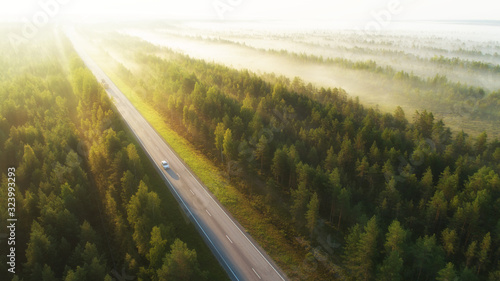Stampa su Tela Aerial view of a highway with cars covered in fog