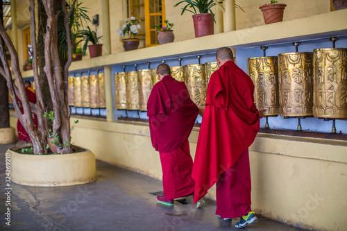 Fotografija Monks spin the golden wheels