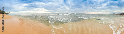 Fotografie, Obraz Panoramic image of cloudy sky and calm indian ocean