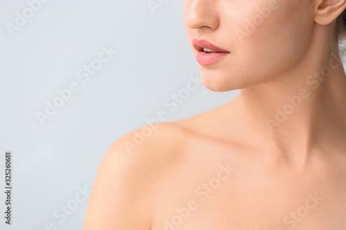 Fototapeta Beautiful young woman on light background, closeup