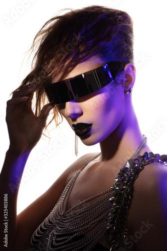 Fotografie, Obraz Colorful portrait of a young woman wearing futuristic glasses