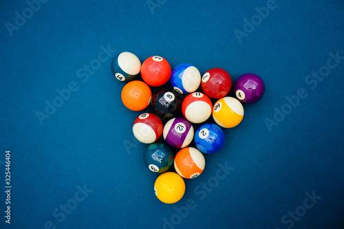 Obraz na plátně Billiard balls on blue pool table, snooker, pool game