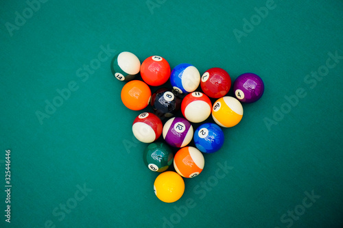 Fototapeta Billiard balls on green pool table, snooker, pool game