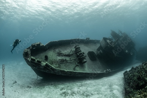 Obraz na plátně Divers examining the famous USS Kittiwake submarine wreck in the Grand Cayman Is