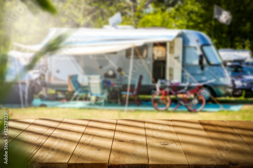 Fényképezés Summer landscape of camping and wooden table of free space for your decoration