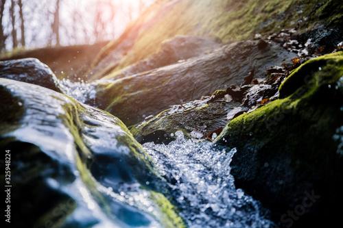 Stampa su Tela water flowing over rocks