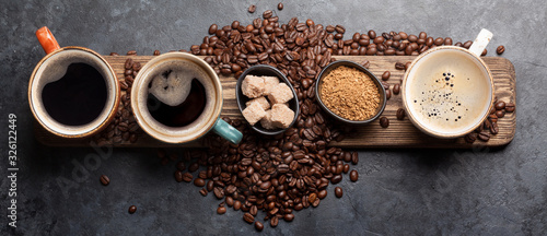 Photo Coffee cup, sugar and roasted beans