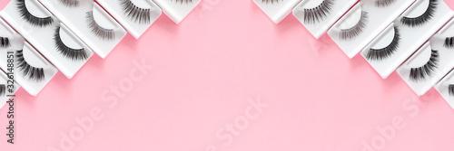 Valokuva Different fake eyelashes on a trendy pastel pink background