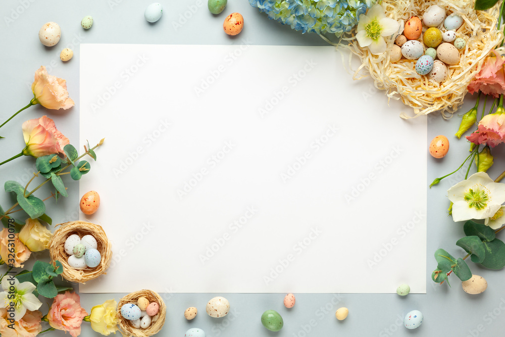 Happy Easter concept with easter eggs in nest and spring flowers. Easter background with copy space. Flat lay <span>plik: #326310078   autor: Svetlana Kolpakova</span>