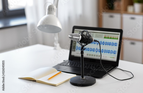 Obraz na plátně post production and technology concept - microphone, laptop computer with sound