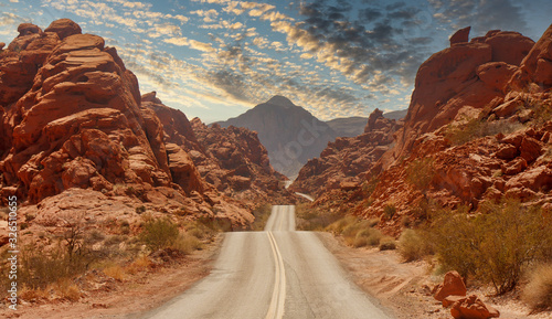 Slika na platnu A highway rolling through red rock canyons in Nevada