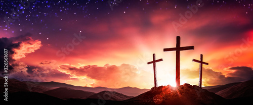 Fotografering Three Wooden Crosses At Sunrise With Clouds And Starry Sky Background - Death An