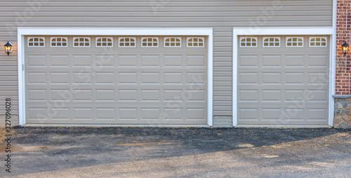 Fotografia, Obraz Two car and single car charcoal gray classic insulated steel raised panel garage