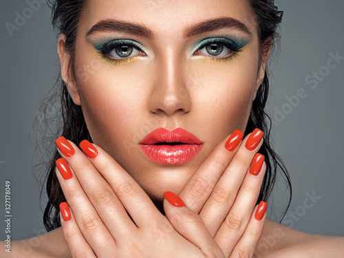 Wallpaper Mural Beautiful woman with bright red lipstick and  nails
